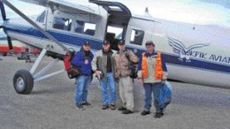 TITAN URANIUMFrom left: Titan Uranium CEO Chad Wasilenkoff, director-chairman Arni Johannson, president Philip Olson and geologist Paul Nichols (orange vest) head out from Baker Lake airport to the company's Thelon basin uranium project in Nunavut.