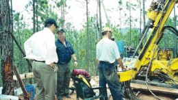 PHOTO BY JOHN CUMMINGUnigold's chairman Talal Ali Al-Shair (left), and COO and vice-president of exploration Daniel Danis (centre) examine a new drill at the company's Los Candelones gold deposit on the Neita property in northwestern Dominican Republic.