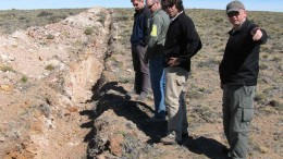 Visitors examine a trench at Argentex Minings Pinguino project in Argentina, led by Argentex president and CEO Ken Hicks (right) and chief geological consultant Diego Guido (second from right).