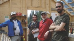 Head of mineral services for the Yukon Geological Survey, Mike Burke (far left), and Atac Resources' president Rob Carne (second from right), with members of the exploration team in the core shack at the Rau gold project.