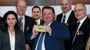 Osisko Mining president CEO Sean Roosen (centre) hoists the company's first gold bar, with members of the executive team at the company's general meeting in May. Photo by Osisko Mining