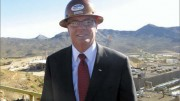 Mark Smith, Molycorp's president and CEO. For more than 24 years, Smith has been involved in the operation and development of the Mountain Pass rare earth element mine in southeastern California, seen in the background. Photo by Trish Saywell