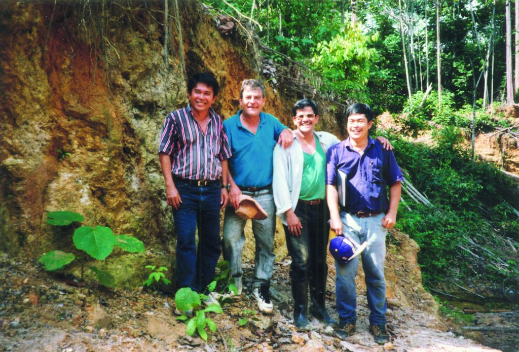 The Bre-X Minerals team at the Busang gold project in East Kalimantan, Indonesia, in 1996, from left: Metallurgist Jerry Alo; John Felderhof; project manager Michael de Guzman; and geologist Cesar Puspos. Photo by The Northern Miner.
