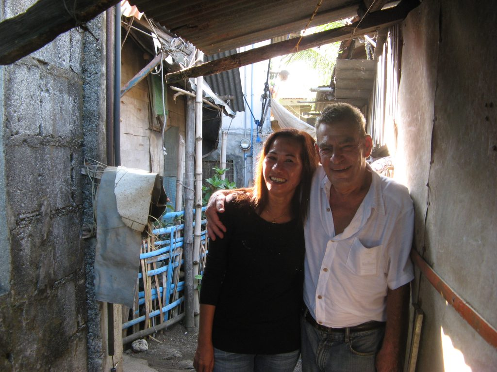 John Felderhof and his wife Maria revisit a squatter village near the sea, where they lived for a time. Photo by Trish Saywell.
