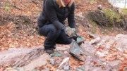 Superior's CEO and president, Judy Baker, examines the high-grade copper minerals on the Batchawana property.