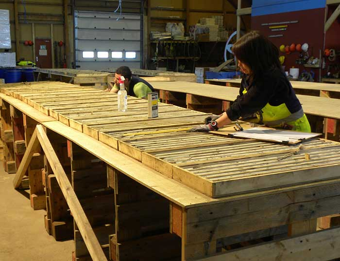Local employees process core at Greenland Minerals and Energy's Kvanefjeld rare earth elements-uranium-zinc project in southern Greenland. Source: Greenland Minerals and Energy