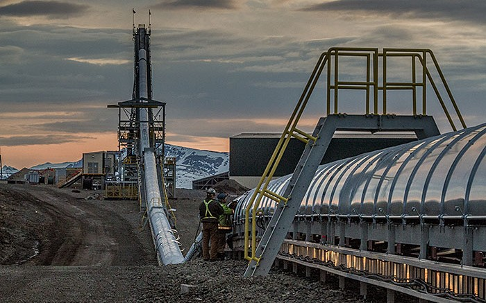 Workers inspect a conveyor at Imperial Metals' Red Chris copper-gold project south of Dease Lake, British Columbia. Credit:  Imperial Metals