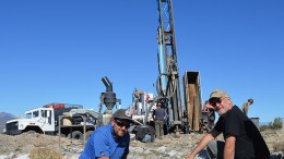Geologist Dan Ferraro (left) and Goldspike Exploration president and CEO Bruce Durham in front of a drill rig at the Lone Mountain zinc-lead project in Nevada.  Credit: Goldspike Exploration