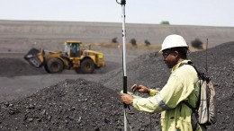 A surveyor measures a coal stockpile at Anglo American's Greenside thermal coal mine in South Africa. Credit: Anglo American