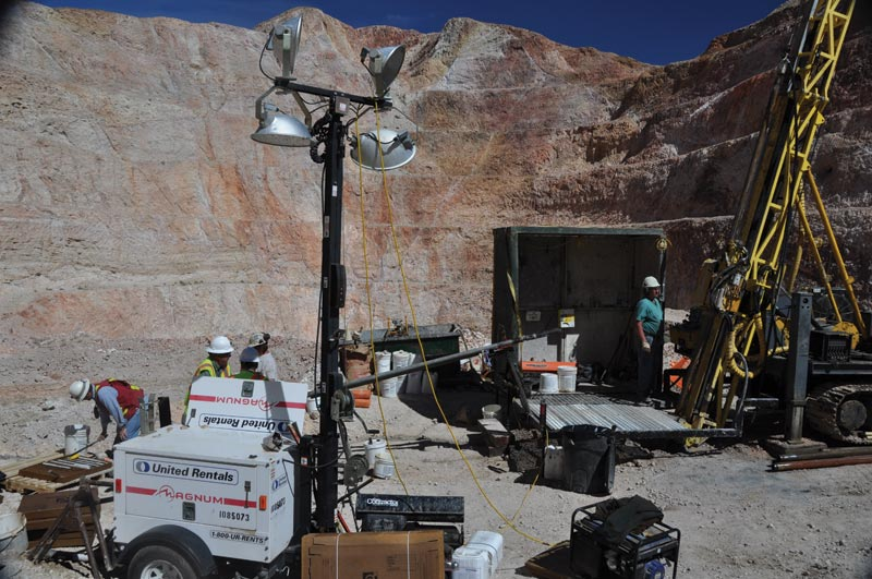 Drillers in 2013 at the historic Oro Belle-Hart Tunnel pit at NewCastle Gold's Castle Mountain gold project in California. Credit: NewCastle Gold