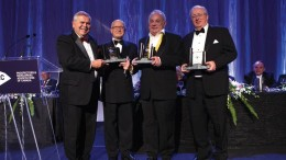 From left: Ed Thompson, chair of the PDAC Awards Committee, with Bill Dennis Award recipients Stephen Roman, Robert Cudney and John Whitton.Photo by Envisiondigitalphoto.com