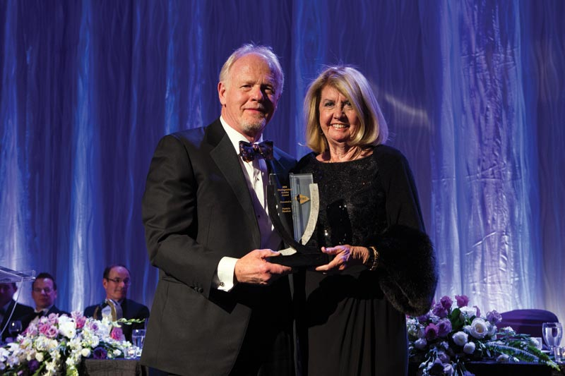 PDAC president Rod Thomas with Distinguished Service Award recipient Patricia Sheahan. Photo by Envisiondigitalphoto.com