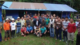 Asiamet Resources' vice-president of exploration Stephen Hughes (centre, sunglasses) with the BKM copper project team in Indonesia.  Credit: Asiamet Resources