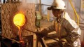 A worker pours gold at Eldorado Gold's White Mountain mine in China's Jilin province. Credit: Eldorado Gold.