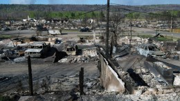 Some of the destruction caused by the wildfire that swept through parts of Fort McMurray, Alberta, earlier this month. Credit: Government of Alberta.