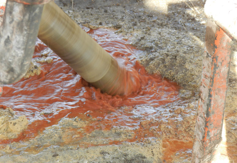 Drilling fluid gushes from a drill hole at Hunt Mining's La Valenciana gold-silver project in Santa Cruz, Argentina.Credit: Hunt Mining.
