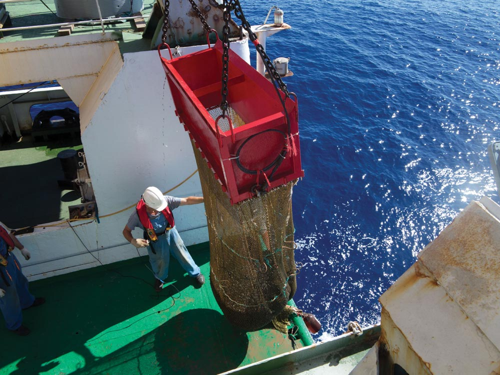 Hauling material up from the seafloor at Nautilus Minerals' Clarion Clipperton zone project (CCZ) in the central Pacific Ocean, 1,000 km south of Hawaii. Credit: Nautilus Minerals.