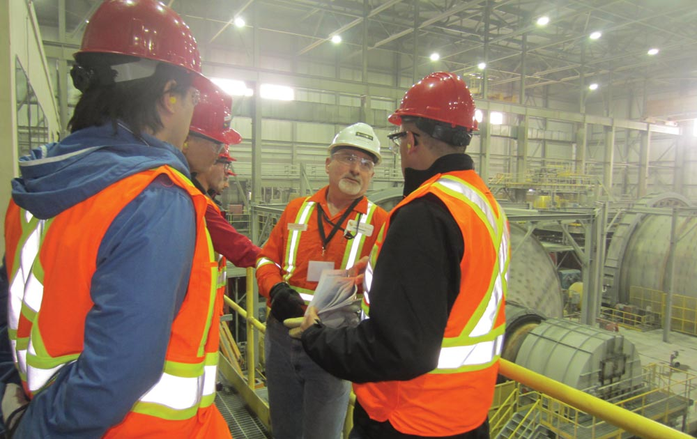 Detour Gold's mine general manager Charles Hennessey (second from right) talks to analysts in the mill at the Detour Lake gold mine in northeastern Ontario. Photo by Salma Tarikh.