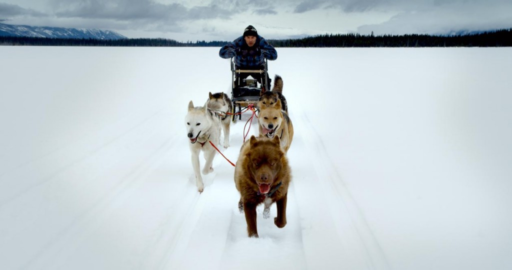 A Tahltan man runs his dogs across the land. Credit: Canada Wide Productions