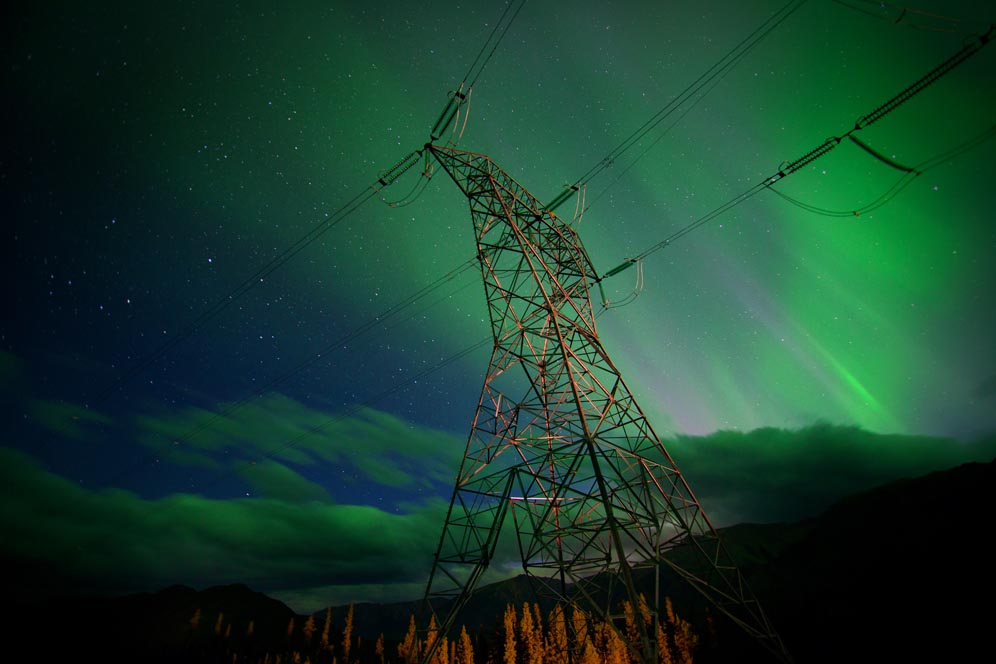 The Northern Lights above a tower on the Northwest Transmission line in B.C. Credit: Canada Wide Productions