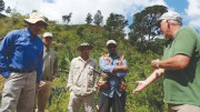 Talking geology at the GoldQuest Mining's Romero gold-copper project in the Dominican Repubic, from left: president and CEO Julio Espaillat, country manager Felix Mercedes, senior field technician Franklin Nunes, senior project geologist Noverto Gonzalez and executive chairman Bill Fisher.  Photo by David Perri.