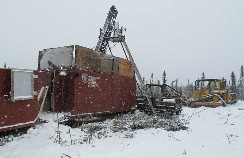 A drill rig in 2013 at TomaGold's 45%-owned Monster Lake gold property, 45 km southwest of Chibougamau in Quebec. Credit: TomaGold.