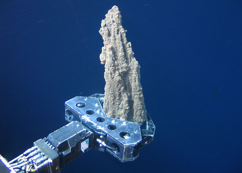 A deep sea remotely operated vehicle (ROV) in the process of taking a chimney sample.