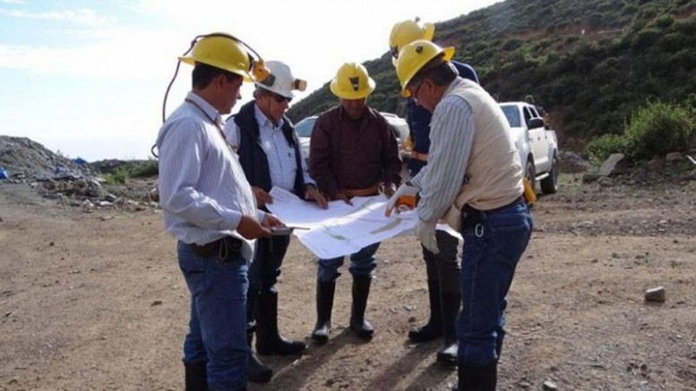 Mining engineers study a map at Lupaka Gold's Invicta project in Peru. Credit: Lupaka Gold.