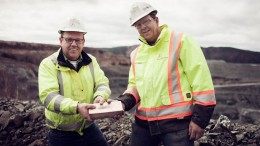 Showing off a gold bar at Anaconda Mining's flagship Point Rousse project on Newfoundland's Baie Verte peninsula. Credit: Anaconda Mining.