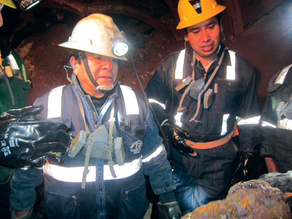Sierra Metals operations manager Bernardo Cabezas (left) eyes a sample during a tour in the Yauricocha polymetallic mine in 2014. Photo by Salma Tarikh.