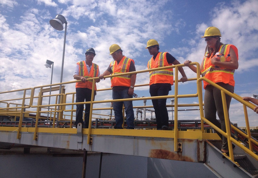 Mill superintendent Jean-Guy St-Jean (far left) shows investors and analysts Integra Gold's Sigma mill complex . Photo by Lesley Stokes.