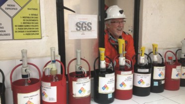 Robert Archer , Great Panther Silver president and CEO, listens in during a tour of the company's SGS-managed laboratory at its GMC silver-gold mine in Guanajuato, Mexico. Photo by Lesley Stokes