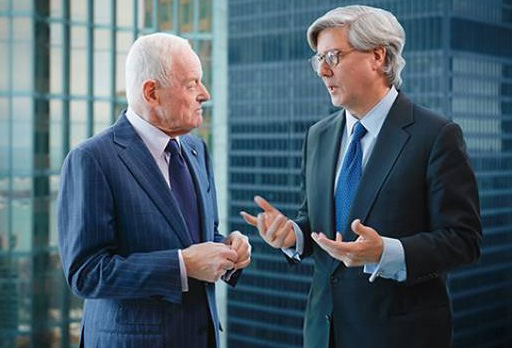 In March 2016, Barrick Gold cuts the pay of executive chairman John Thornton (at right, with Barrick founder Peter Munk in a 2014 photo) by 76% for 2015 after shareholder criticism. Credit: Barrick Gold.