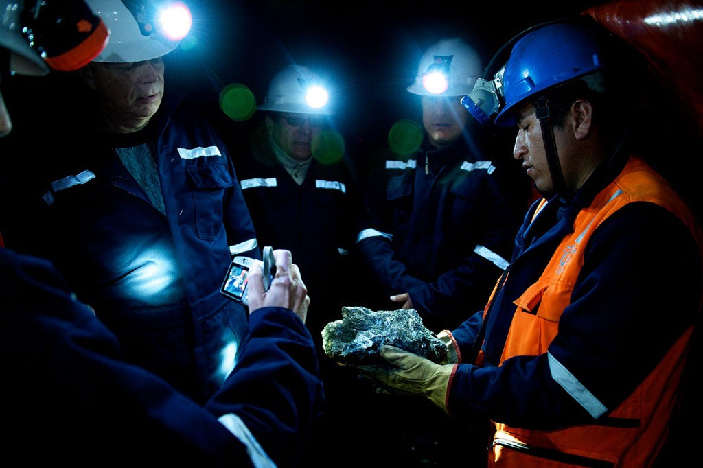 Examining a rock sample at Dynacor Gold Mines' Tumipampa gold-copper project, 500 km southeast of Lima. Credit: Dynacor Gold Mines.