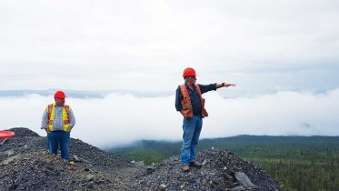 Alexco Resource's president and CEO Clynton Nauman (left) and vice-president of exploration Alan McOnie pause on the way up Galena Hill to explain historic operations at the Hector-Calumet mine at the Keno Hill silver property in the Yukon. Photo by Matthew Keevil.