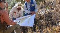Geologists examine a map at Almaden Minerals' Ixtaca epithermal gold-silver deposit 95 km north of Puebla City, Mexico. Credit: Almaden Minerals.
