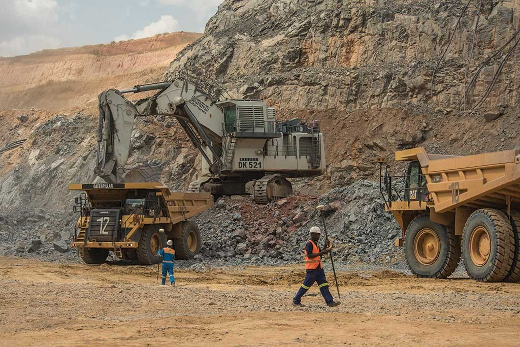 Workers and heavy equipment in a pit at Randgold Resources' Tongon gold mine in northern Côte d'Ivoire. Credit: Randgold Resources.