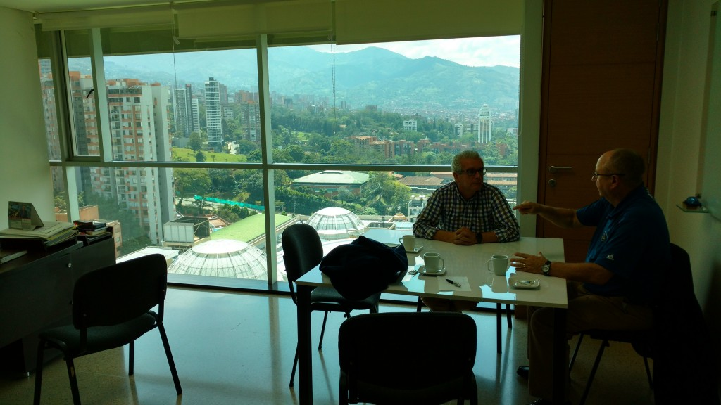 At Antioquia Gold's corporate offices in Medellin, Colombia (from left): Julián Villarruel, president of Antioquia Gold's Colombian subsidiary; and Jim Decker, executive vice-president of investor relations. Photo by John Cumming.