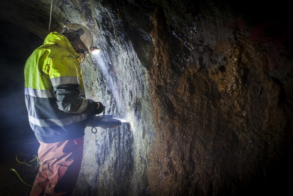 Employee completing a channel sample in the Curraghinalt underground. Credit: Dalradian Resources.