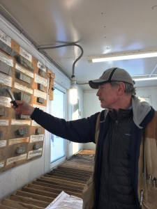 IGC's consultant Dean Turner points out a drill core sample from Malmyzh's Valley deposit. Photo by Salma Tarikh.
