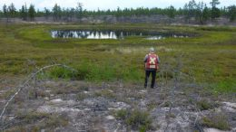A geologist overlooks a potential kimberlite target at CanAlaska's West Athabasca diamond project in the Athabasca Basin of northwest Saskatchewan. Credit: CanAlaska Uranium.