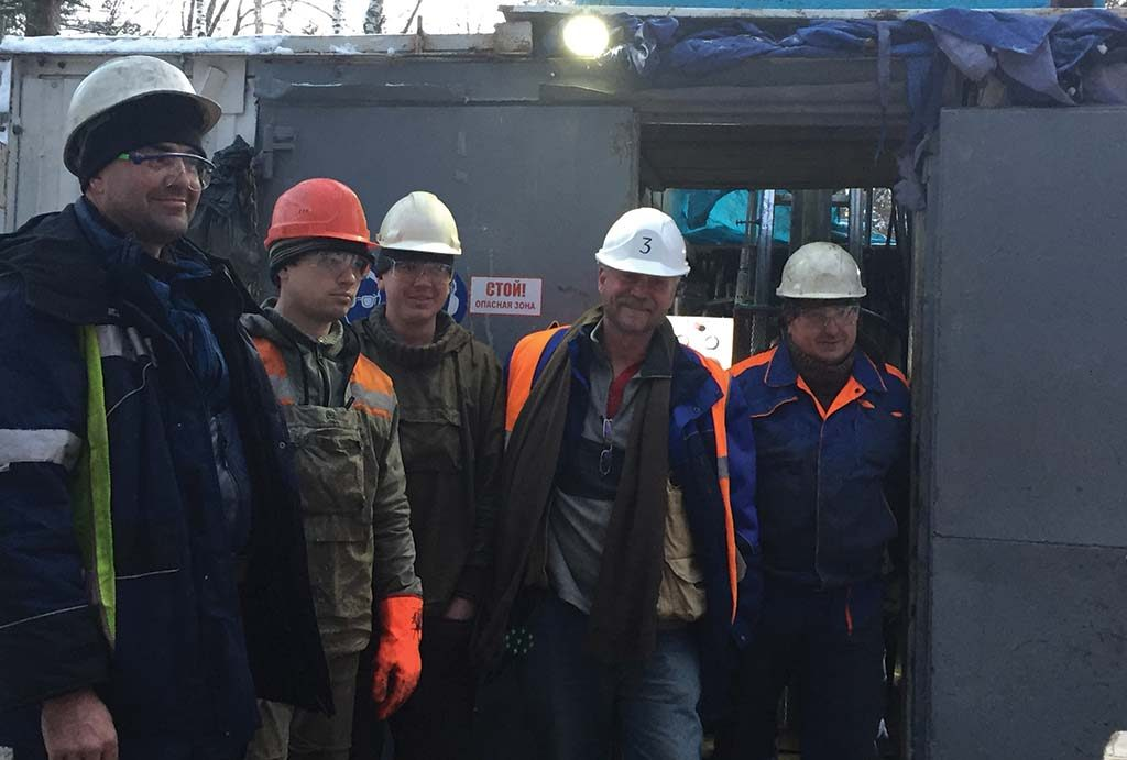 IG Copper's CEO Tom Bowens (second from right) with a drill crew at the Malmyzh copper-gold property. Photo by Salma Tarikh.