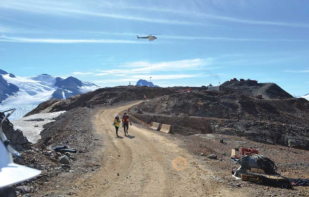 Visitors approach the portal at IDM Mining's Red Mountain gold project in northwest British Columbia. Photo by Matthew Keevil.