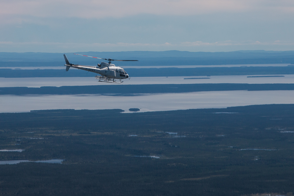 A helicopter flies over Eastmain Resource's 100%-owned Eastmain project in Quebec. Credit: Eastmain Resources