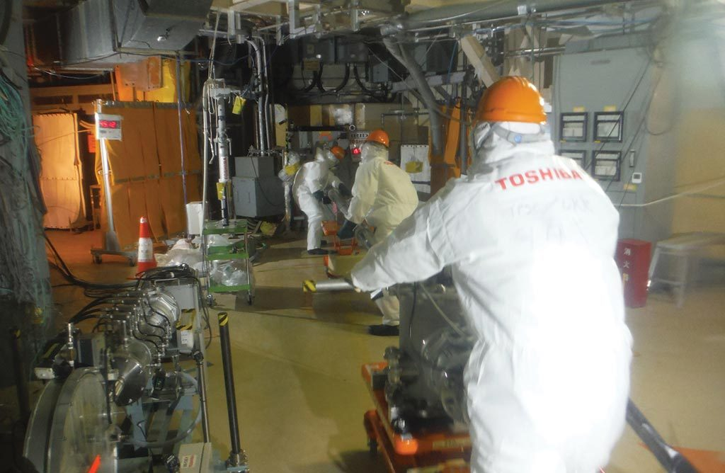 Workers conducting a primary containment vessel investigation in February at Tepco's disabled Fukushima Daiichi nuclear power station in Japan. Credit: International Research Institute for Nuclear Decommissioning.