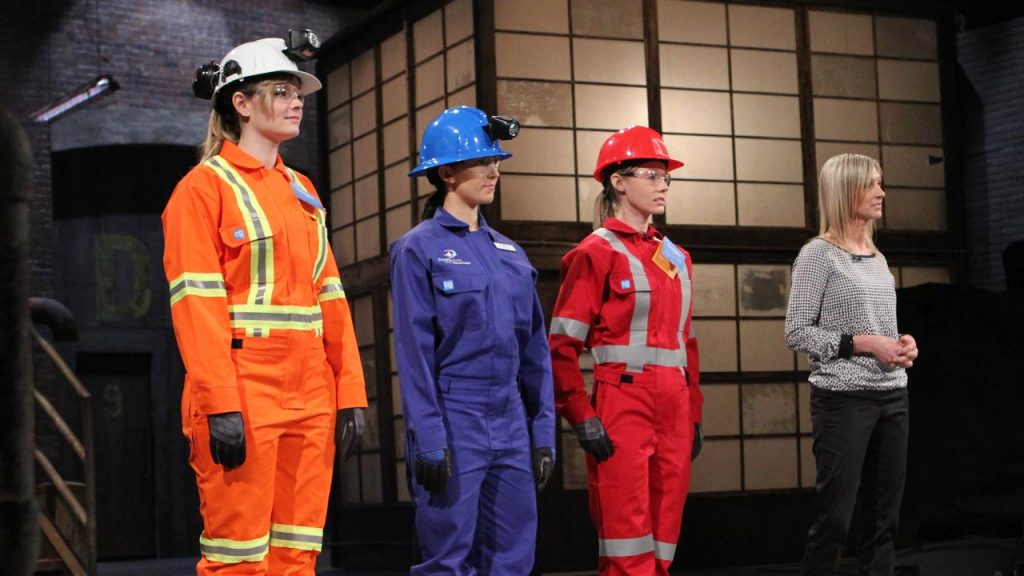 Alicia Woods (far right) appearing with three workwear models on Season 9 of CBC's Dragon's Den TV show, pitching her Covergalls concept to a group of potential investors. Credit: Canadian Broadcasting Corp.