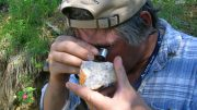 Prospector Shawn Ryan examining a rock at Underworld Resources' White Gold property in the Yukon in 2009. Photo by The Northern Miner.