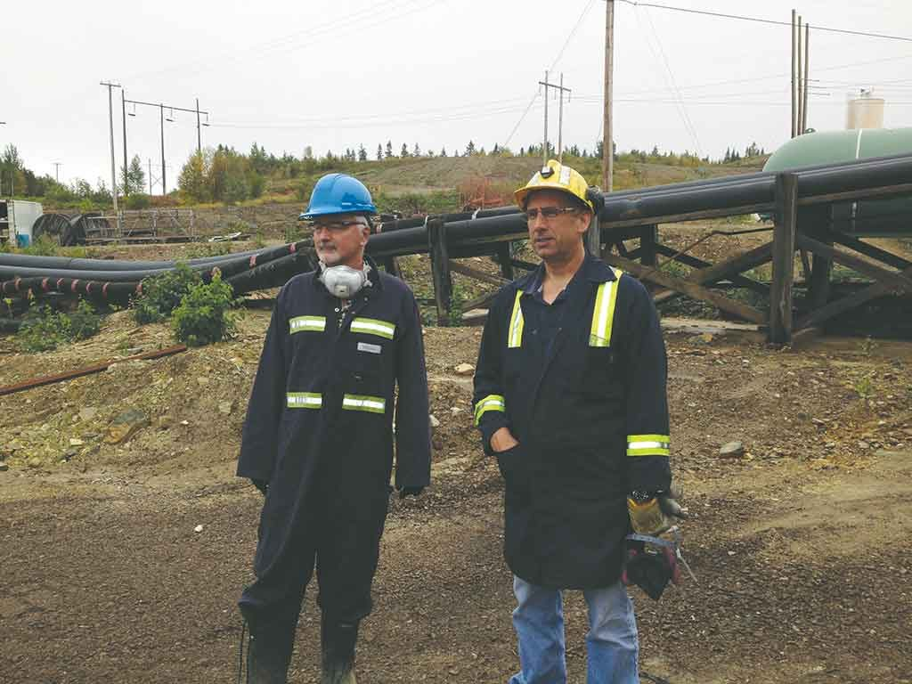 Trevali Mining president and CEO Mark Cruise (left) in 2015 at the Caribou zinc mine, 50 km west of Bathurst, New Brunswick. Photo by Salma Tarikh.