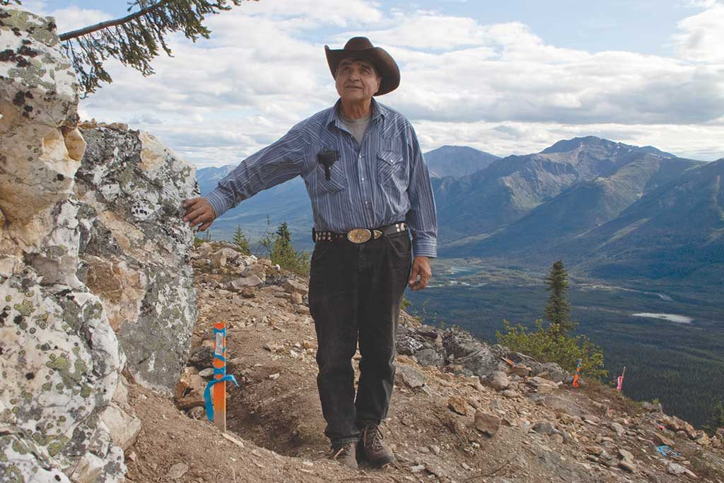Prospector Alex McMillan at the discovery vein on Golden Predator's 3 Aces gold project in the Yukon in 2011. Photo by The Northern Miner.