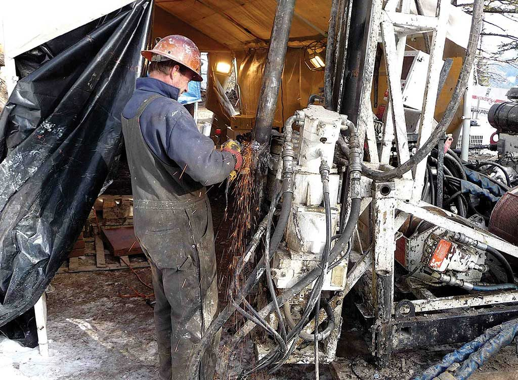 A driller at work on a rig at the Kilgore gold property. Credit: Otis Gold.